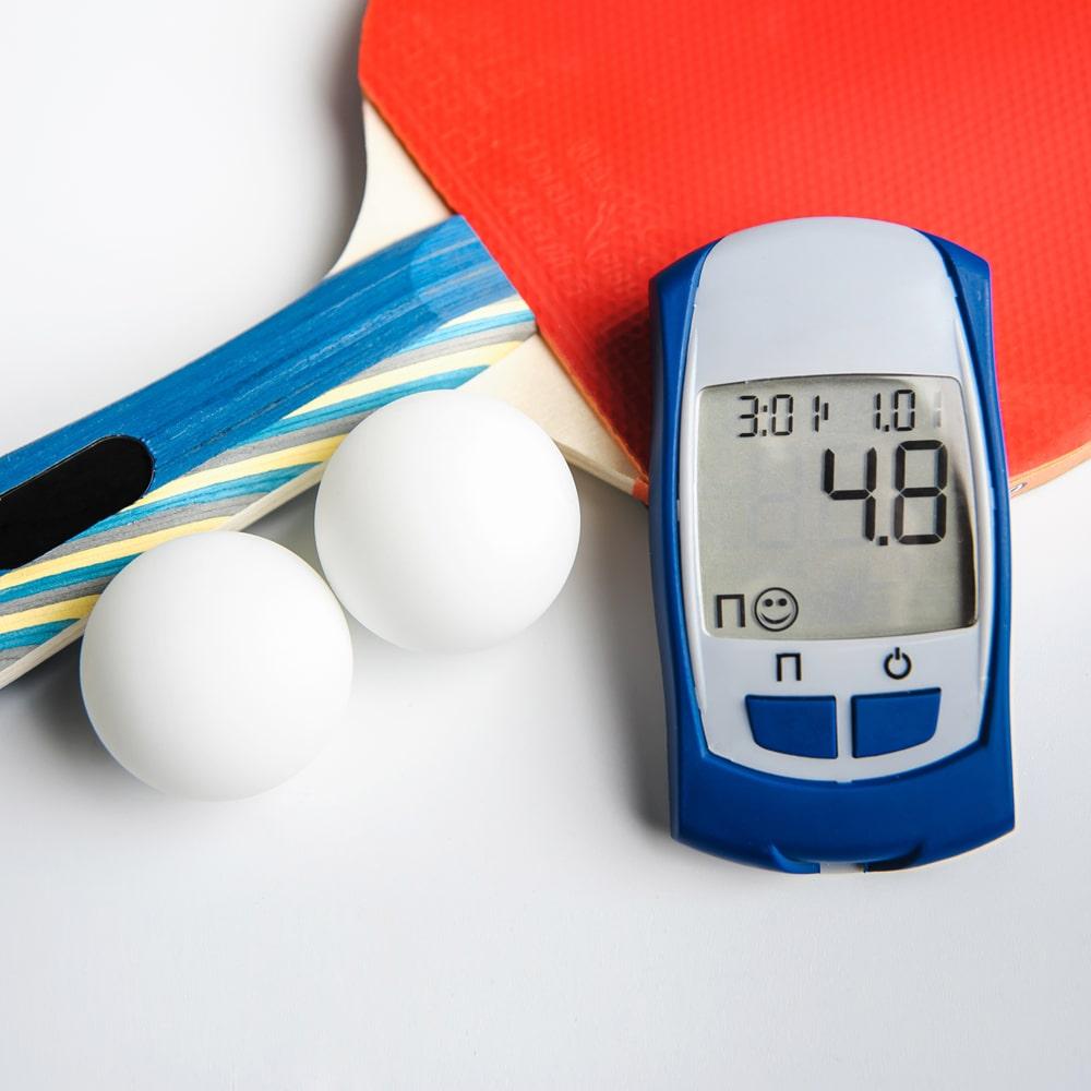 Diabetes Blutzucker-Testgerät und Sport-Bewegung.